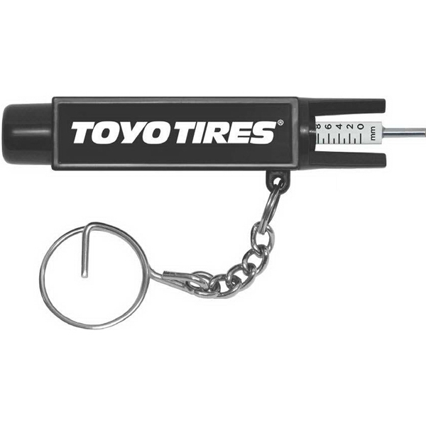 Tire Tool Key Tag. Pressure And Tread Depth Gauge In One Handy Tool Photo