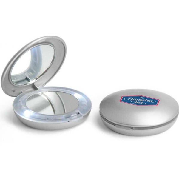 Compact Vanity Mirror With Light In A Silver Case Photo