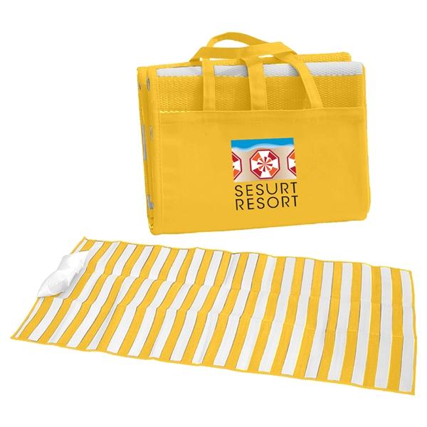 Beach Mat - Beach mat with inflatable pillow made of tubular polypropylene material.