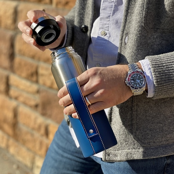 Stainless steel bottle with vegan leather sleeve