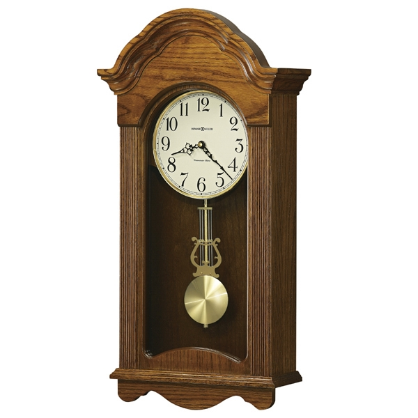 Jayla - Legacy Oak Clock With Scalloped Arched Bonnet And Brass Finish Pendulum Photo