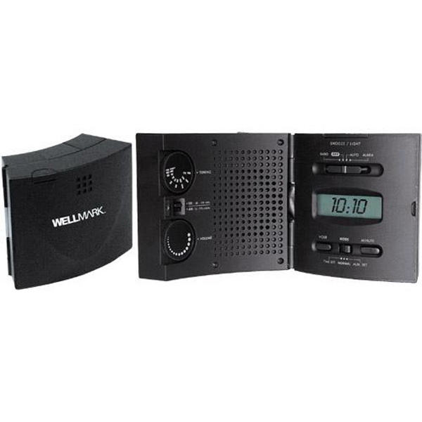 "AM/FM ""Wave"" radio and lighted alarm clock - AM/FM travel alarm clock radio with wave shape case and large LCD display."