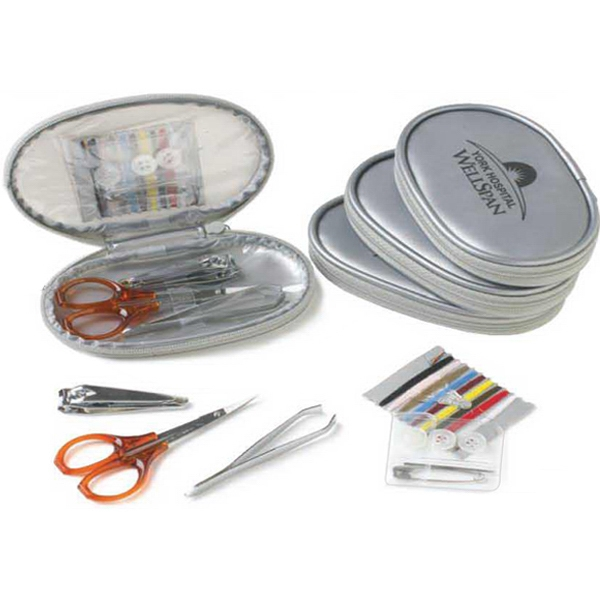 Silver Flash - Three Stainless Steel Nail Care Tools And A Sewing Kit Photo
