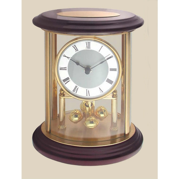 Pendulum Clock Highlighted In Beautiful Gold Accents, Glass And Wood Finish Photo