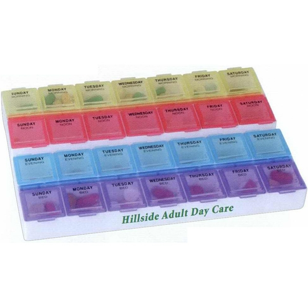 Pill Box With 28 Individual Compartments. Setup To Four Times A Day Photo