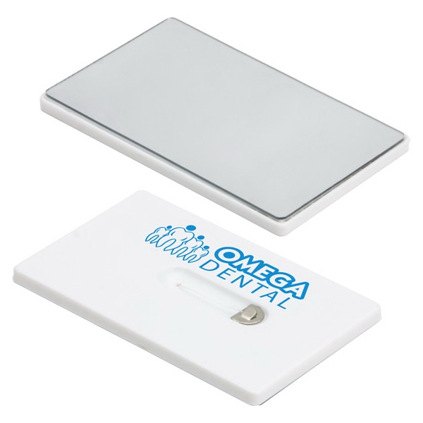 Credit Card Dental Floss With Made From Waxed Nylon And A Mirror Made From Plastic Photo