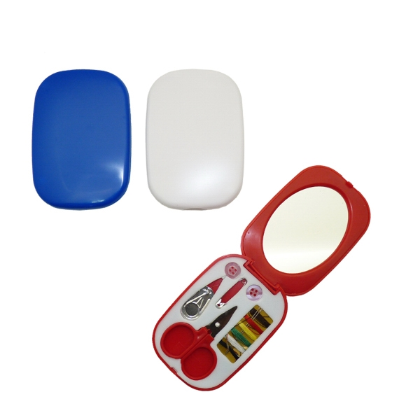 Compact sewing kit with enclosed mirror