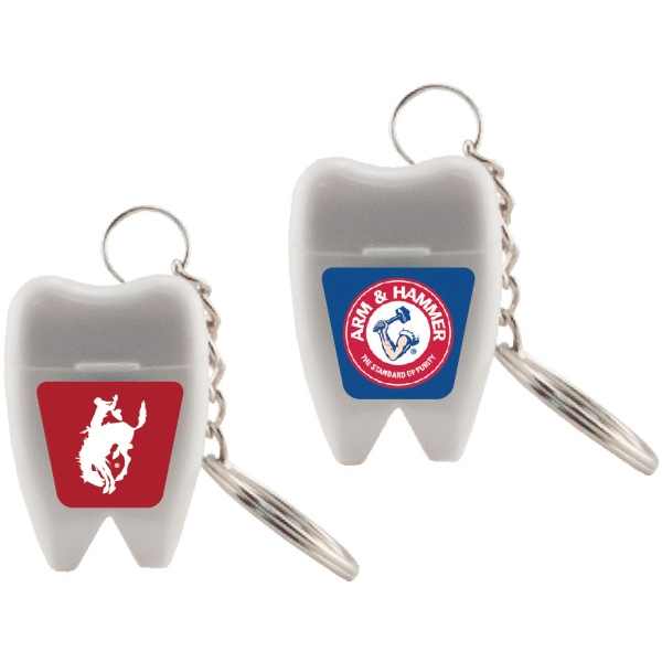 Floss Master - Tooth Shaped Dental Floss. Dental Floss With Key Chain In Tooth Shaped Container Photo