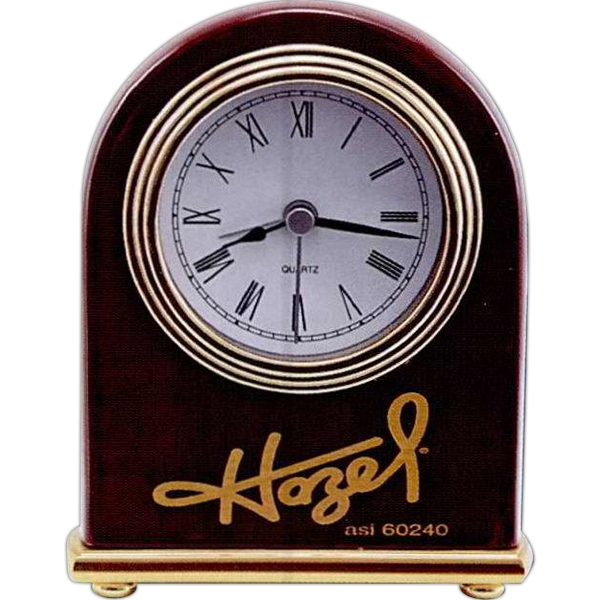 This Round Arch Desk Clock Shows The Time In Sleek Black Roman Numerals Photo