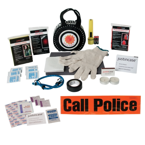 Safe-t-tire - 40 Piece Auto Safety Kit In A Wheel Shaped Case Photo