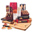 Bamboo Party Platter - paddle cutting board with cheese, sausage, crackers, and other food items