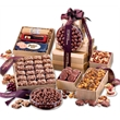 Grand Gourmet Tower - gold striped tower filled with chocolates, nuts, and other food items