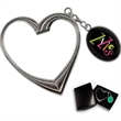 Heart Shaped Bag Hanger. - Heart Shaped Swivel Bag Hanger. Holds bags up to 12 pounds.