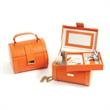 Jewelry Case With Removable Tray - Orange leather jewelry case with removable tray.
