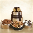 Delicious Delights Snack Tower - Black and gold snack tower filled with cookies, pretzels and chocolate.