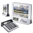 """3-in-1 Calculator/Picture Frame/Digital Clock - 6 1/16"""" H x 5 1/4"""" W x 2"""" calculator, picture frame and LCD digital clock combination product."""