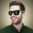 Dollar Sign Novelty Sunglasses - Plastic novelty sunglasses featuring a green dollar sign on both lenses.