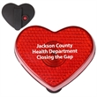 Heart Flashing Button - Blinking heart-shaped light with sturdy clip on back and on/off button.