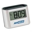 """Ambi Solar Desk Alarm Clock - 1.25"""" x 1.75"""" x 2.75"""" Ambi solar digital desk alarm clock; includes indoor and outdoor solar panel."""
