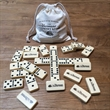Double 6 Dominoes with Spinner in Bag - Enjoy the sweet clicking sound of the club-sized with their smooth ivory surface with clean, black pips