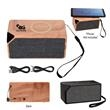 "Boost Wireless Charger Speaker - 4 1/4"" x 2"" x 2 1/4"" wireless combo speaker and charger; black or wood product colors available."