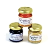 Mustard - Mustards - a little sweet, a little tangy. Comes in glass jars less than 2 oz. each.