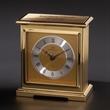 "Interlude Clock - 5.25"" x 4.75"" x 2.5"" desk clock with glass front panel, metal dial, quartz movement and Roman numerals."