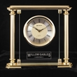 Victoria Clock - Desk clock with brass-colored case with satin finished columns suspended in 10mm thick glass.
