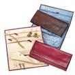 Diamond District Jewelry Roll - Leather jewelry roll with faux-suede interior lining and storage pockets.