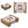 Round Absorbent Stone Coaster Set - Set of 4 round absorbent stone coasters with cork backing and a wooden holder.